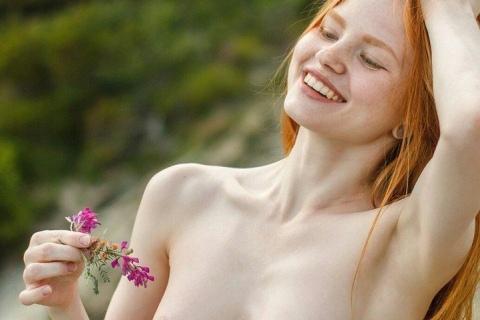 nudist-beautiful-redhead-smiling-girl-flowers-nature