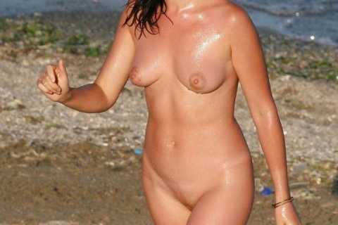 nudist-girl-thongue-out-beach